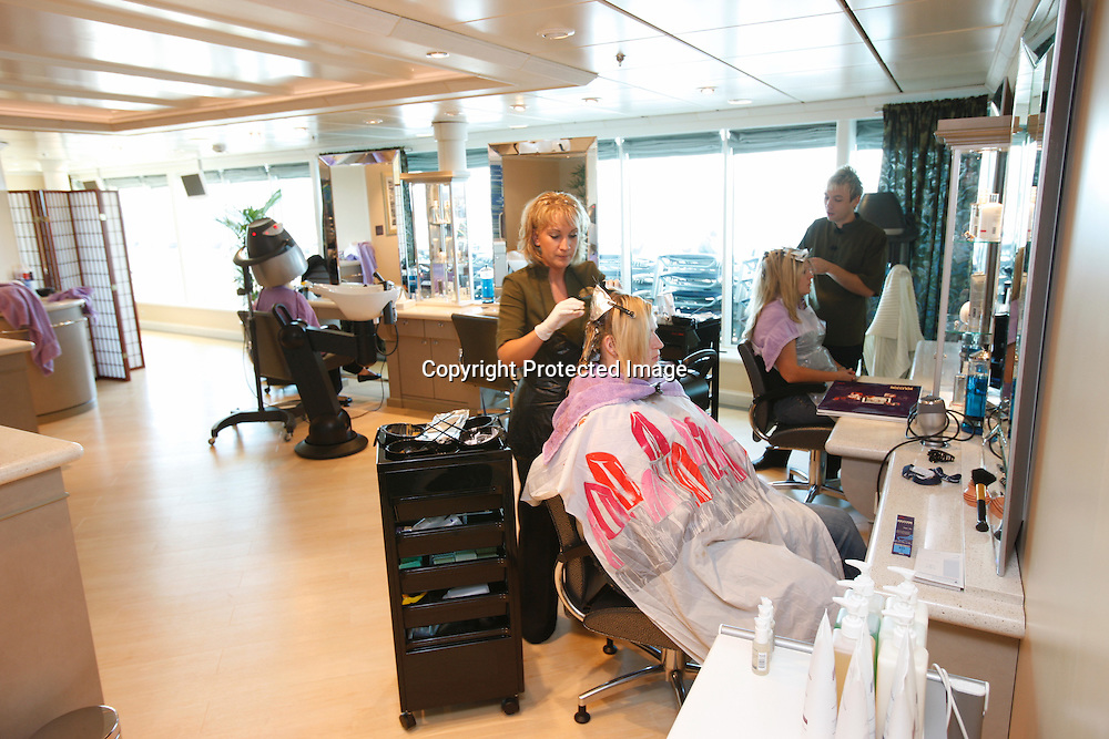 Royal Caribbean International's  Independence of the Seas, the world's largest cruise ship.....Hair dressing in the Spa area.