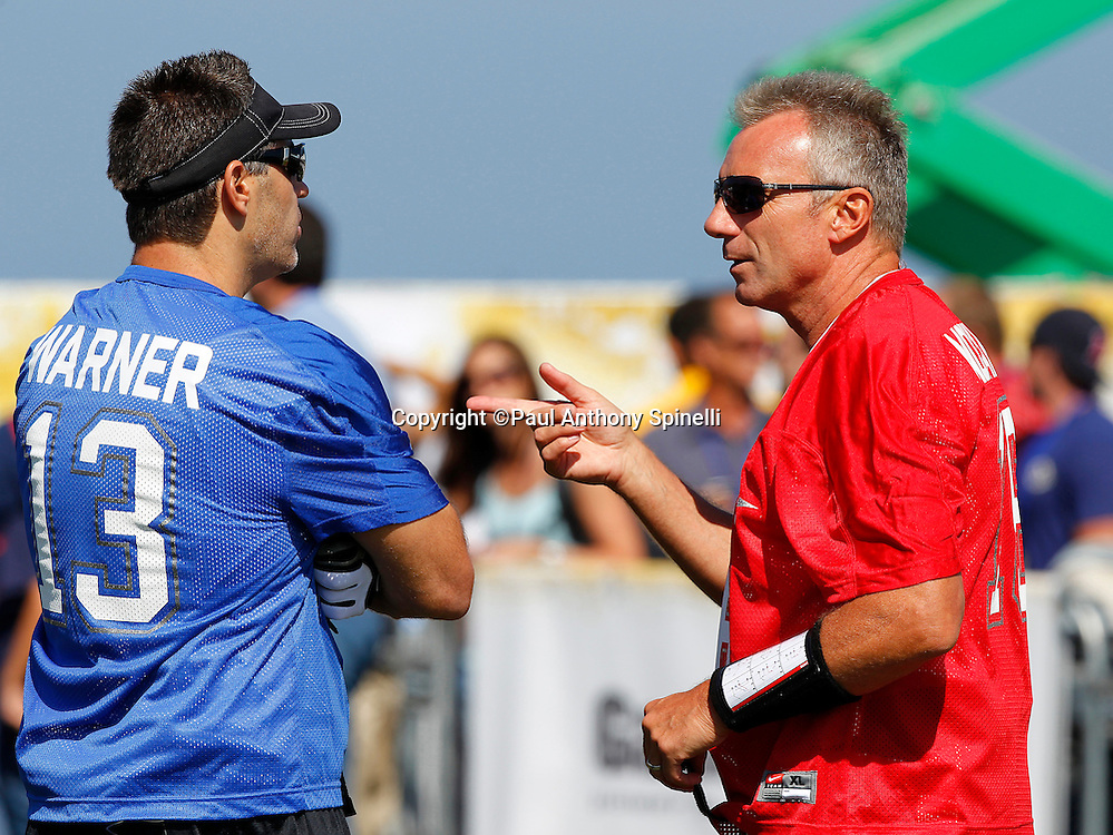Former San Francisco 49ers quarterback Joe Montana (16) of the Gamers team chats with former Arizona Cardinals quarterback Kurt Warner (13) of the Famers team as they get ready to play flag football in the EA Sports Madden NFL 11 Launch celebrity and NFL player flag football game held at Malibu Bluffs State Park on July 22, 2010 in Malibu, California. (©Paul Anthony Spinelli)