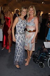 Left to right, LINDKA CIERACH and DEBBIE MOORE at a private view of fashion designer Lindka Cierach's Couture Dresses drawn by Trudy Good held at the Belgravia Gallery, 45 Albemarle Street, London on 21st September 2005.<br />