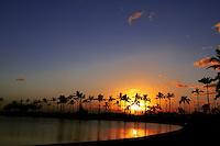 The sun sets over the lagoon at the Hilton Hawaiian Village Resort.