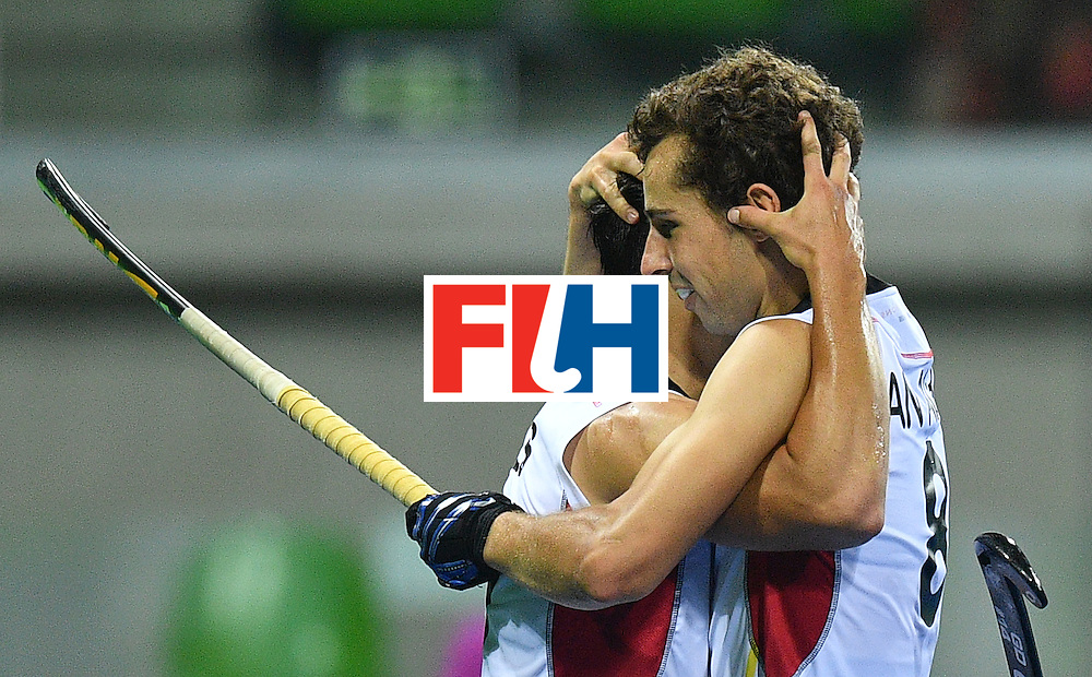 Belgium's Florent van Aubel (R) celebrates a goal with teammate Belgium's Thomas Briels  during the men's semifinal field hockey Belgium vs Netherlands match of the Rio 2016 Olympics Games at the Olympic Hockey Centre in Rio de Janeiro on August 16, 2016.  / AFP / Carl DE SOUZA        (Photo credit should read CARL DE SOUZA/AFP/Getty Images)