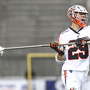 Lee Zink #29 of the Denver Outlaws passes the ball during the game at Harvard Stadium on May 10, 2014 in Boston, Massachusetts. (Photo by Elan Kawesch)