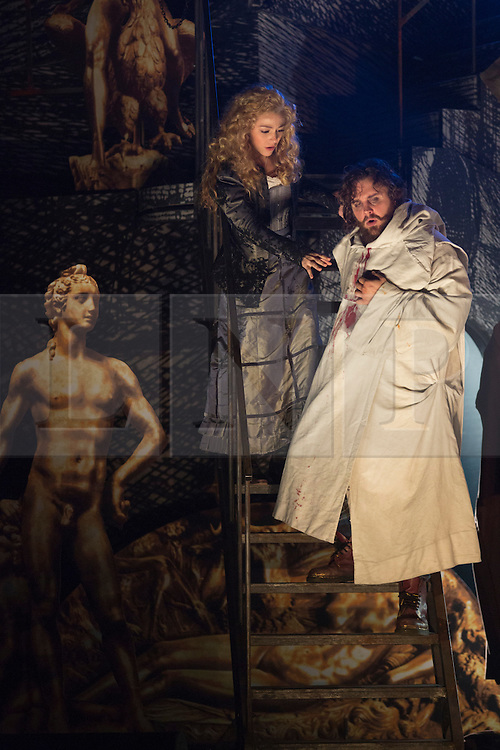 "© Licensed to London News Pictures. 02/06/2014. London, England. Michael Spyres as Benvenuto Cellini and Corinne Winters as Teresa. Dress rehearsal of the Hector Berlioz opera ""Benvenuto Cellini"" at the London Coliseum. Directed by Monty Python and movie director Terry Gilliam for the English National Opera. Benvenuto Cellini opens on 5 June for 8 performances. As part of ENO Screen, the opera will be broadcast live to over 300 cinemas in the UK and Ireland and selected cinemas worldwide on 17 June 2014. Co-production with De Nederlandse Opera, Amsterdam and Teatro dell'Opera di Roma. Michael Spyres as Benvenuto Cellini, Pavlo Hunka as Balducci, Corinne Winters as Teresa, Nicholas Pallesen as Fieramosca and Willard White as Pope Clement VII. Photo credit: Bettina Strenske/LNP"