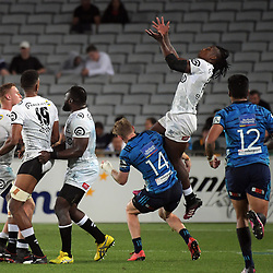 Blues winger Jordan Trainor tackles Sbu Nkosi in mid-air during the Super Rugby match between the Blues and Sharks at Eden Park in Auckland, New Zealand on Saturday, 31 March 2018. Photo: Dave Lintott / lintottphoto.co.nz