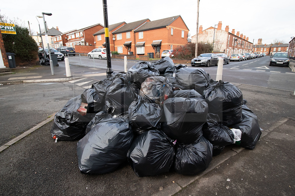 © Licensed to London News Pictures. 20/02/2019. Birmingham, UK. Birmingham bin men work to rule. Pictured, a large collection of rubbish in Tarry Road, Alum Rock. Industrial action by Birmingham waste collection services is resulting in a build up of rubbish on the streets in areas of the City. Photo credit: Dave Warren/LNP