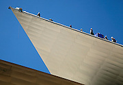 Workers in climbing harnesses replace the roof of the Denver Art Museum in downtown Denver, Colorado June 30, 2009. The Daniel Libeskind-designed building features highly sloped walls and roof. REUTERS/Rick Wilking (UNITED STATES SOCIETY IMAGES OF THE DAY)