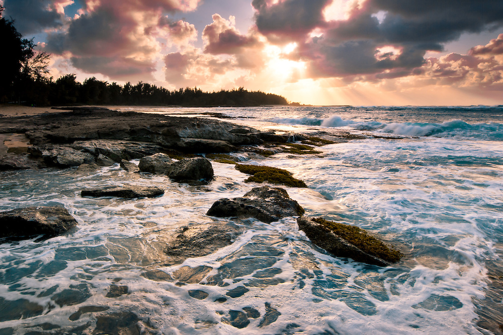 Surf and rocks at sunset on Oahu's Turtle Bay, Hawaii
