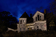 Full moon setting behind a ruined house, Searsport, Maine