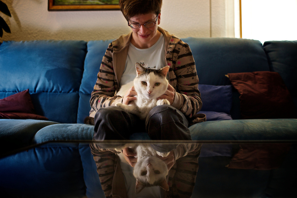 Carol at home, Mollens, with her cat Flipper