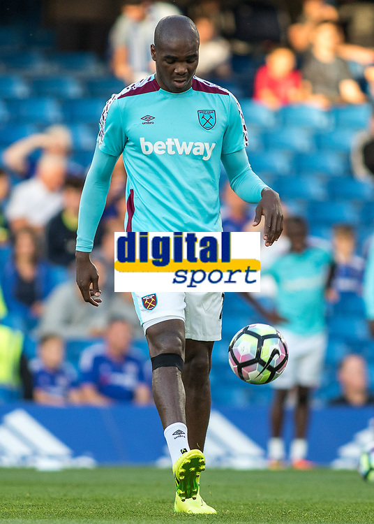 Football - 2016/2017 Premier League - Chelsea V West Ham United. <br /> <br /> Andre Ayew of West Ham warms up at Stamford Bridge.<br /> <br /> COLORSPORT/DANIEL BEARHAM