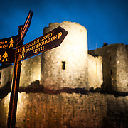 Direction signs at Harlech Castle in Harlech, Gwynedd, on the northwest coast of Wales next to the Irish Sea. The castle was built by Edward I in the closing decades of the 13th century as one of several castles designed to consolidate his conquest of Wales.