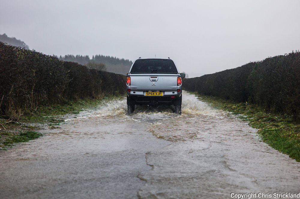 Denholm, Hawick, Scottish Borders, UK. 5th December 2015.  Flooded roads are common place after the River Teviot burst its banks due heavy rainfall in the Scottish Borders.