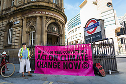 © Licensed to London News Pictures. 13/09/2019. London, UK. An Extinction Rebellion banner outside City of London Magistrates court this morning. Over 50 defendants from across the UK are appearing at City of London Magistrates court in London today, charged with being public assembly participants failing to comply with police conditions related to Extinction Rebellion climate change protests in London. Photo credit: Vickie Flores/LNP