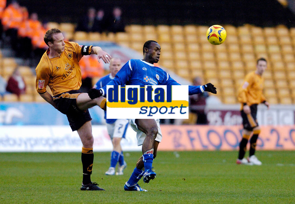 Photo: Leigh Quinnell.<br /> Wolverhampton Wanderers v Leicester City. Coca Cola Championship. 09/12/2006. Wolves captain Jody Craddock clears the ball away from Leicesters Elvis Hammond.