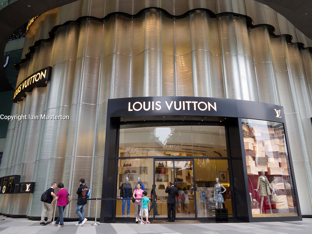 Louis Vuitton luxury boutique in modern shopping mall in Orchard Road in Singapore