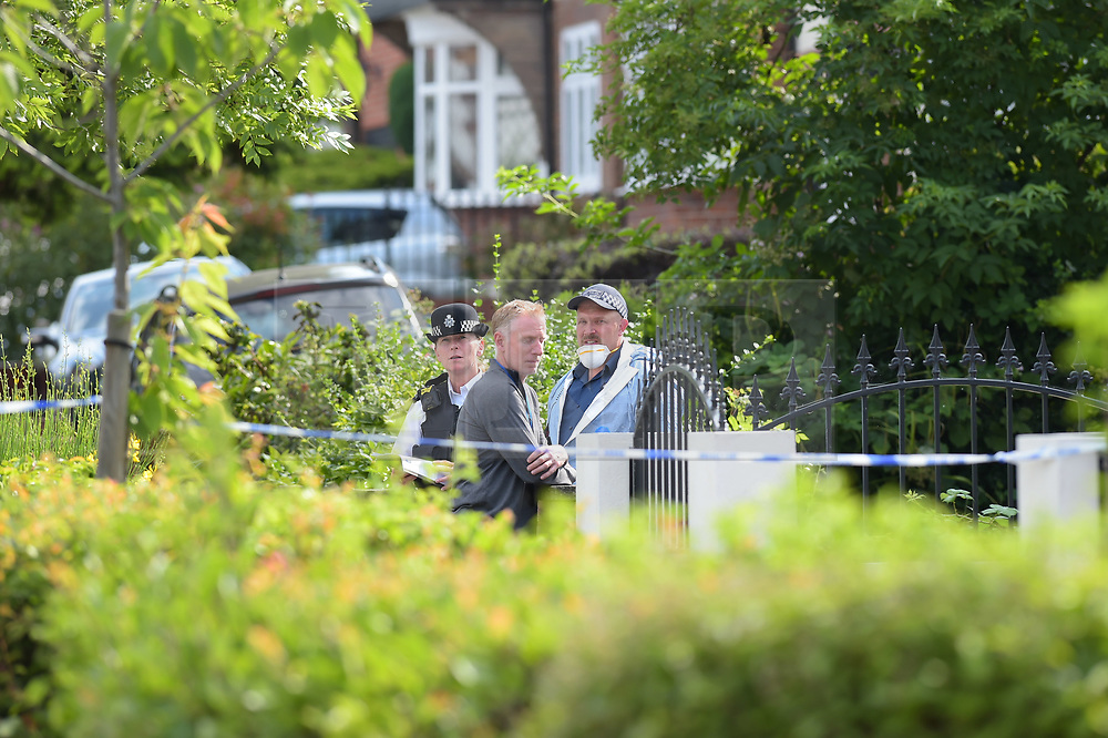 © Licensed to London News Pictures. 15/07/2019. London UK: Police search teams prepare to search a house in  Malvern Drive in Woodford Green, Essex after a male in his forties was found with gun shot wounds and rushed to hospital, where his condition is described as critical  , Photo credit: Steve Poston/LNP