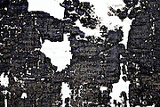 Fragments of text thought to be by Epicurean writer and philosopher Philodemus, in a roll buried and carbonized in the library of a villa at Herculaneum in AD 79 at the eruption of Vesuvius. .This image is quite maniplated to get some good detail and to make it more interesting.