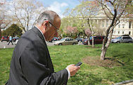 Representative Steve King (R-IA) looks at his cell phone as he walks up to the US Capitol Building in Washington, DC on Tuesday, April 16, 2013.