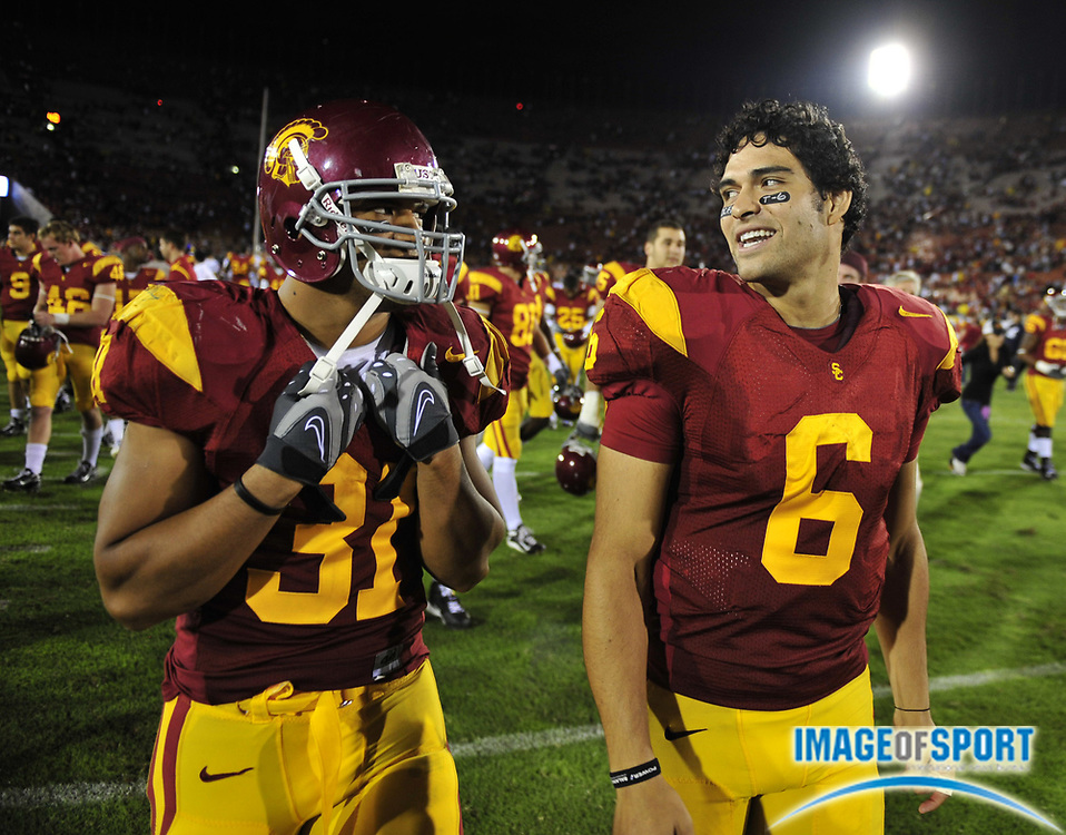 Nov 1, 2008; Los Angeles, CA, USA; Southern California Trojans quarterback Mark Sanchez (6), right, and fullback Stanley Havili (31) celebrate after 56-0 victory over the Washington Huskies at the Los Angeles Memorial Coliseum.