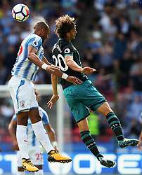 Mathias Zanka Jorgensen of Huddersfield Town challenges for a header with Manolo Gabbiadini of Southampton - Mandatory by-line: Matt McNulty/JMP - 26/08/2017 - FOOTBALL - The John Smith's Stadium - Huddersfield, England - Huddersfield Town v Southampton - Premier League