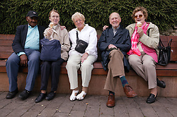 Group of elderly people sitting on a bench,