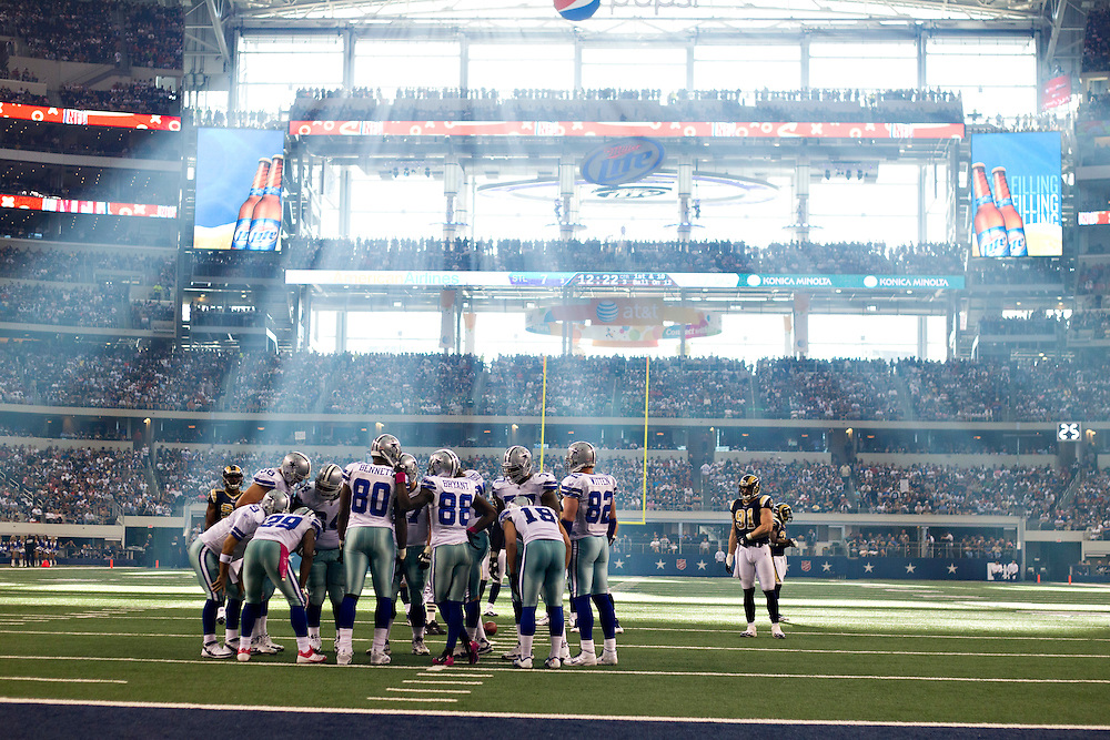 ARLINGTON, TX - OCTOBER 23:   Offense of the Dallas Cowboys huddles together on the field during a game against the St. Louis Rams at the Cowboy Stadium on October 23, 2011 in Arlington, Texas.  The Cowboys defeated the Rams 34 to 7.  (Photo by Wesley Hitt/Getty Images) *** Local Caption ***