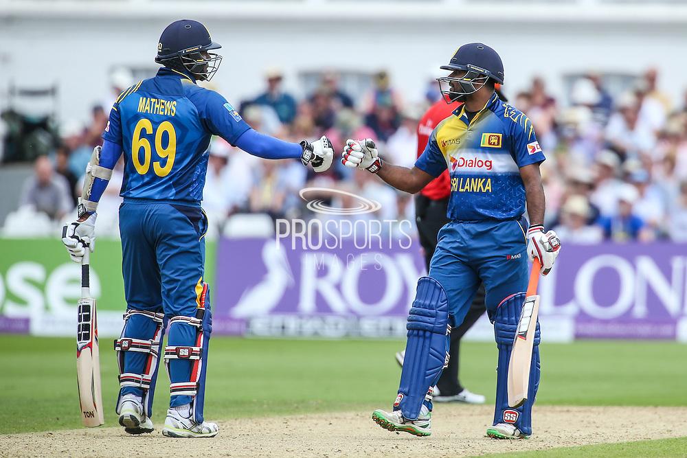 Sri Lanka's Seekkuge Prasanna and Sri Lanka's Angelo Mathews during the Royal London ODI match between England and Sri Lanka at Trent Bridge, West Bridgford, United Kingdon on 21 June 2016. Photo by Shane Healey.