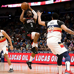 Mar 24, 2019; New Orleans, LA, USA; Houston Rockets guard Chris Paul (3) passes as New Orleans Pelicans forward Anthony Davis (23) defends during the first quarter at the Smoothie King Center. Mandatory Credit: Derick E. Hingle-USA TODAY Sports