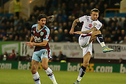 Milton Keynes Dons midfielder Carl Baker gets a shot on goal  during the Sky Bet Championship match between Burnley and Milton Keynes Dons at Turf Moor, Burnley, England on 15 September 2015. Photo by Simon Davies.