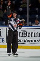 KELOWNA, CANADA - NOVEMBER 25: Referee Ryan Benbow calls a penalty against the Kelowna Rockets against the Medicine Hat Tigers on November 25, 2017 at Prospera Place in Kelowna, British Columbia, Canada.  (Photo by Marissa Baecker/Shoot the Breeze)  *** Local Caption ***