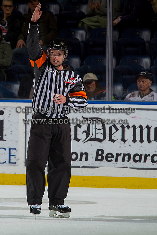 KELOWNA, CANADA - NOVEMBER 25: Referee Ryan Benbow calls a penalty against the Kelowna Rockets against the Medicine Hat Tigers on November 25, 2017 at Prospera Place in Kelowna, British Columbia, Canada.  (Photo by Marissa Baecker/Shoot the Breeze)  *** Local Caption ***