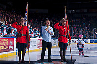 KELOWNA, CANADA - NOVEMBER 11: Jeff Piatelli sings the national anthem between two RCMP against the Red Deer Rebels on November 11, 2017 at Prospera Place in Kelowna, British Columbia, Canada.  (Photo by Marissa Baecker/Shoot the Breeze)  *** Local Caption ***