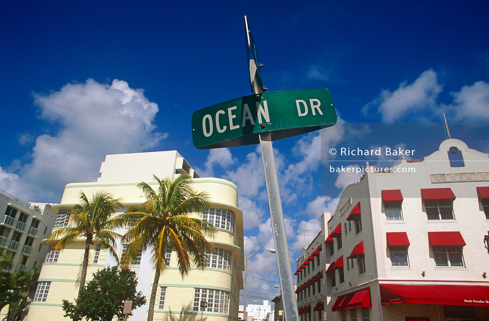 A street signpost and Art Deco architecture on Ocean Drive, Miami, on 15th May 1996, in Miami Beach, Florida, USA.