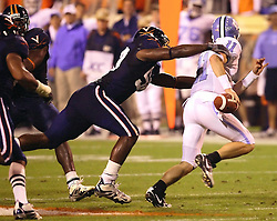 Antonio Appleby sacks UNC's Cam Sexton (11) for a 13 yard loss in the first half.  Virginia sacked UNC quarterbacks 3 times as the Wahoo defense shutout the Tar Heels 23-0 at Scott Stadium in Charlottesville, VA on Thursday, October 19, 2006.