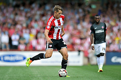 Brentford's James Tarkowski - Photo mandatory by-line: Patrick Khachfe/JMP - Mobile: 07966 386802 09/08/2014 - SPORT - FOOTBALL - Brentford - Griffin Park - Brentford v Charlton Athletic - Sky Bet Championship - First game of the season