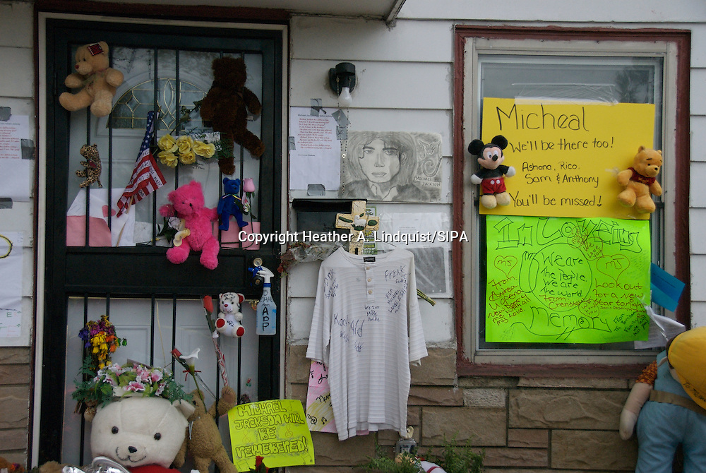 29 June 2009 - Gary, IN..2300 Jackson Street, the modest childhood home of the King of Pop, Michael Jackson and his family of eleven. Fans came from all over to pay their respects after his death on June 25th, 2009...Photo Credit: Heather A. Lindquist/SIPA...