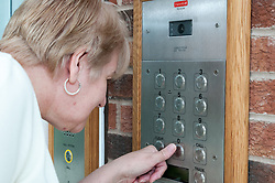 Pensioner in supported housing using the door entry system