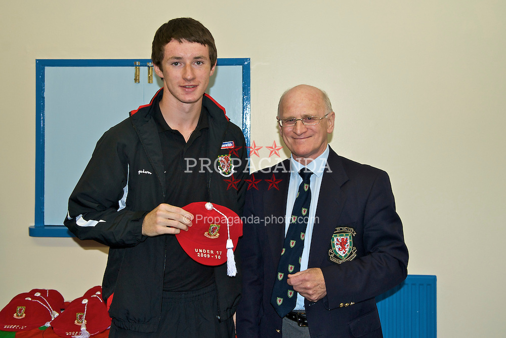 HAVERFORDWEST, WALES - Saturday, October 3, 2009: Wales' Will James is presented with his cap by FAW Council member Ken Tucker after the UEFA Under-17 Championship Qualifying Round Group 12 match against Russia at Bridge Meadow Stadium. (Pic by David Rawcliffe/Propaganda)