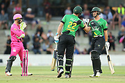 Stags Josh Clarkson and Will Young pound gloves after scoring another boundary during the Burger King Super Smash Twenty20 cricket match Knights v Stags played at Bay Oval, Mount Maunganui, New Zealand on Wednesday 27 December 2017.<br /> <br /> Copyright photo: &copy; Bruce Lim / www.photosport.nz