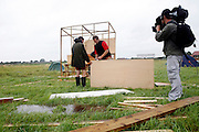 Climate change activists are challenging the weather, and the authorities, by setting up a seven-day-long camp 800 meters from Heathrow airport to protest against climate change and the expansion plans for the airport on Tuesday, Aug. 14, 2007, in Hayes and Harlington, England. Aviation is the fastest growing source of greenhouse gas emissions in the UK, and all our efforts to tackle climate change in other sectors are undone by the massive growth in air travel. Holding the camp at Heathrow aims to highlight the paradoxical government's airport expansion plans, target industry giants profiteering from the climate crisis, and raise awareness about the need to fly less. The camp also support local residents in their long-term struggle against the building of a third runway and the destruction of their communities. Heathrow, the world's busiest international airport, has been the target of Climat Camp campaing in 2007. www.climatecamp.org.uk  **Italy Out**.
