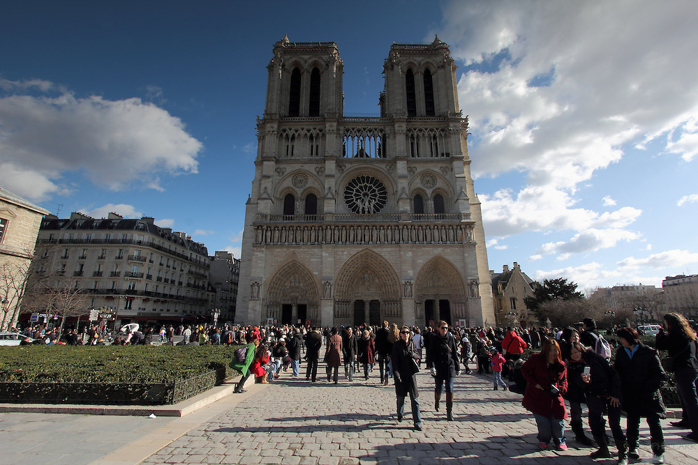 Crowds of people visit Notre Dame in Paris every day.