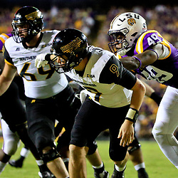 Oct 15, 2016; Baton Rouge, LA, USA;  LSU Tigers defensive end Arden Key (49) pressures Southern Miss Golden Eagles quarterback Nick Mullens (9) during the third quarter of a game at Tiger Stadium. Mandatory Credit: Derick E. Hingle-USA TODAY Sports