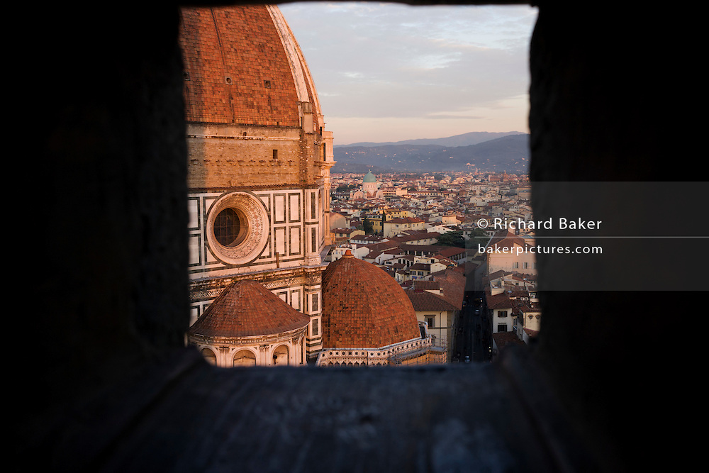 Brunelleschi's Dome seen from Giotto's Bell Tower (campanile).The Basilica di Santa Maria del Fiore is the cathedral church (Duomo) of Florence, Italy, begun in 1296 in the Gothic style to the design of Arnolfo di Cambio and completed structurally in 1436 with the dome engineered by Filippo Brunelleschi. The exterior of the basilica is faced with polychrome marble panels in various shades of green and pink bordered by white and has an elaborate 19th century Gothic Revival facade by Emilio De Fabris. The cathedral complex, located in Piazza del Duomo, includes the Baptistery and Giotto's Campanile. The three buildings are part of the UNESCO World Heritage Site ..