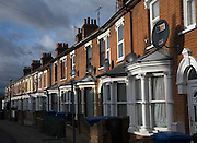 Row terraced red brick housing with  TV satellite dishes