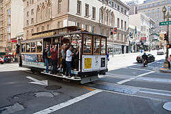 San Francisco, CA: a cable car on the Powell & Mason Line approaches a stop on Powell Street in city center.