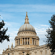 The distinctive dome of St Paul's Cathedral in London against a mostly blue sky.