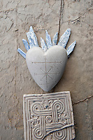 Fun stone heart etched with a cryptic map and flaming blue Kyanite.