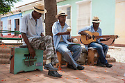 A male trio of buskers from the music group Sorpresa Trinitaria, playing in Plazuela del Cristo, Trinidad, Cuba