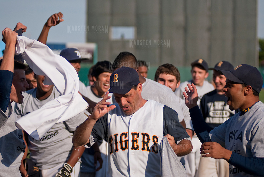 June 12, 2010 - Bronx, NY : The long drive to Coney Island was worth it for the RKA baseball team who rounded out a perfect 16-0 season with a come-from-behind 5-2 win over Gregorio Luperon on June 12 to bring home the school's first ever PSAL championship title. Head coach John Reingold shakes off water after having a tub of gatorade dumped on him.