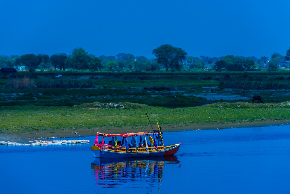 Ferry boats crossing the Yamuna River at Gotam Nagar, Vrindavan, Uttar Pradesh, India.